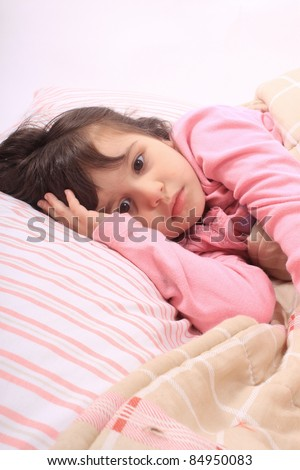 cute little girl laying in bed and can 39 t fall asleep stock photo 84950083 shutterstock. Black Bedroom Furniture Sets. Home Design Ideas