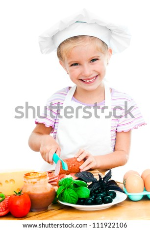 cute little girl little girl cuting sausage on a white