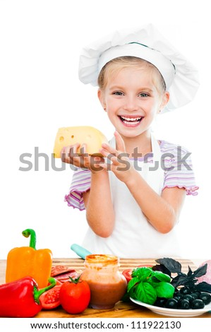 cute little girl little girl holding cheese on a white