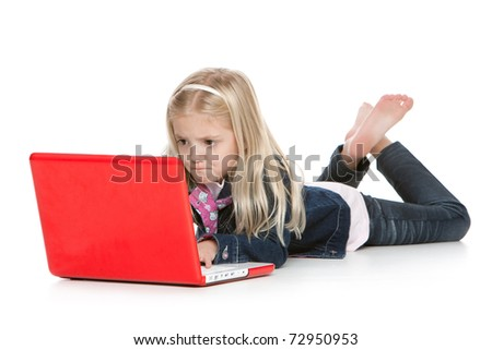 Cute little girl lying down with laptop isolated on white background