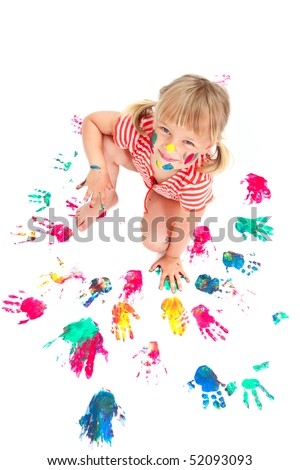 Cute little girl making hand prints. Isolated on white background.