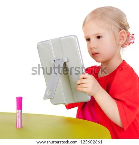 cute little girl making makeup