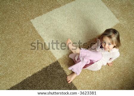 Cute little girl on carpet