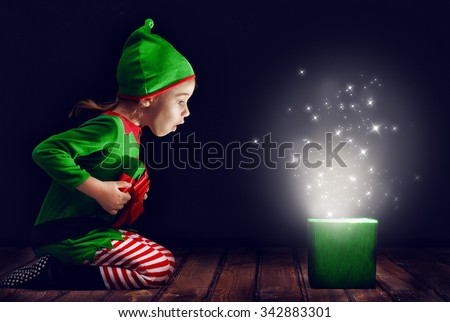 Cute little girl opening a magic gift box. #342883301