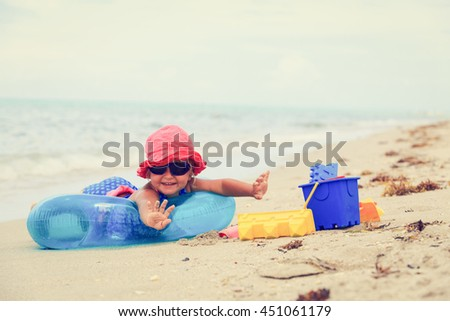 cute little girl play on summer beach #451061179