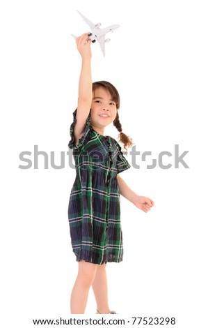 Cute little girl play with toy airplane on white background