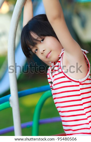Cute little girl playing in a children playground