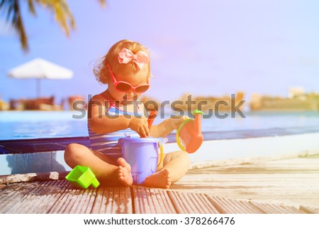 cute little girl playing in...