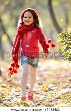 cute little girl playing outdoor in autumn