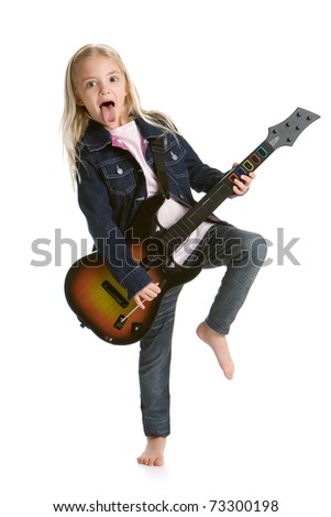 Cute little girl playing video game guitar
