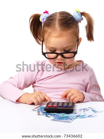 Cute little girl plays with money, isolated over white