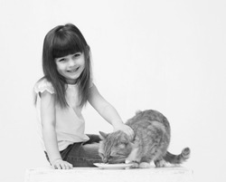Cute little girl portrait hug a cat smiling black and white