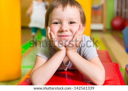 Cute little girl portrait in daycare gym