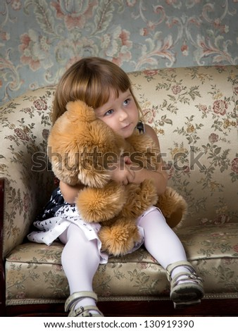 Cute little girl portrait in studio with teddy-bear