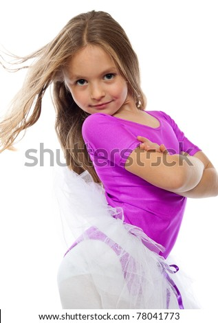 cute little girl posing after training, isolated on white