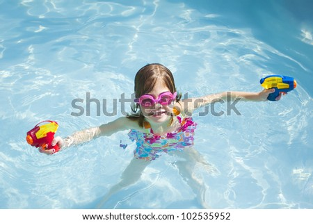 Cute little Girl Ready For a Water Fight