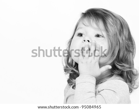 Cute little girl send kiss, monochrome portrait