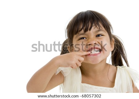 cute little girl showing her teeth, isolated on white background