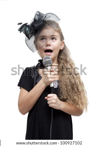 Cute little girl singing into a microphone on a white background