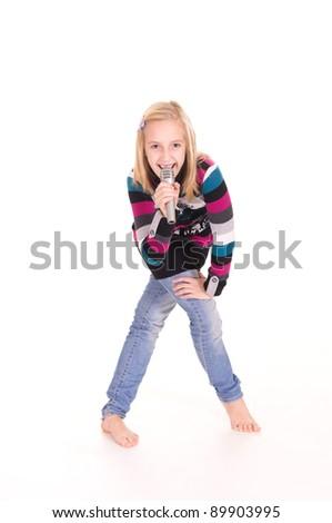cute little girl singing with microphone on white