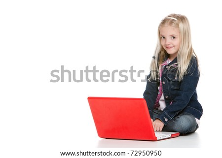 Cute little girl sitting down with laptop isolated on white background