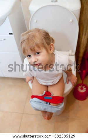 Cute Little Girl Sitting On Toilet In Bath Free Images