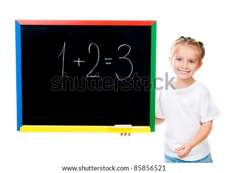 cute little girl standing near blackboard isolated on white - stock photo