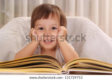 cute little girl studying  at the table at home - stock photo