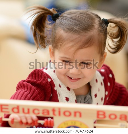cute little girl using education board - stock photo