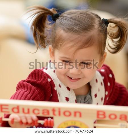 cute little girl using education board