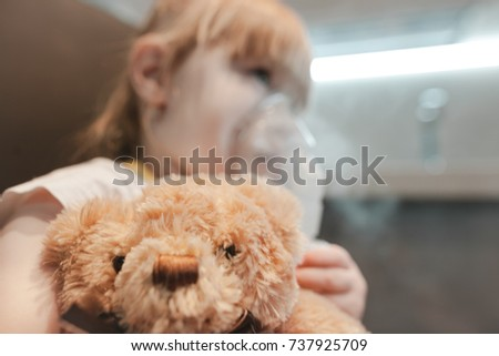 Cute little girl using nebulizer on white background. Allergy concept #737925709