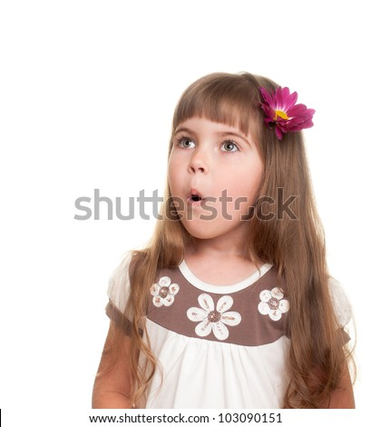 cute little girl very surprised and looking up somewhere with bud of chrysanthemum in hair against white background