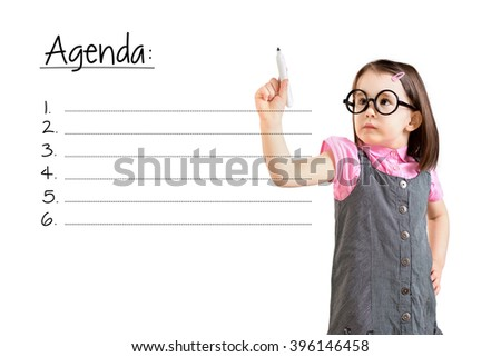 Cute little girl wearing business dress and writing blank agenda list. White background.