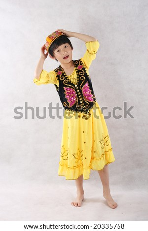 cute little girl wearing colorful clothes - stock photo