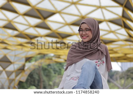 Cute little girl wearing hijab casually as personal style in the morning at the park. #1174858240