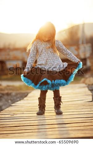 Cute little girl wearing tutu skirt
