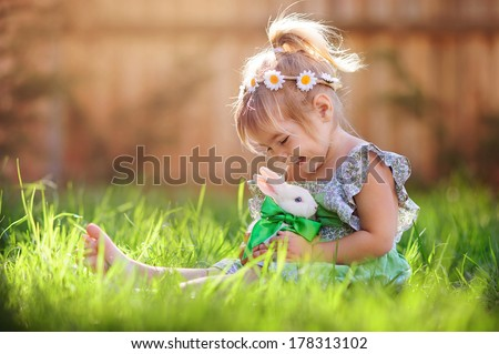 cute little girl with a bunny...
