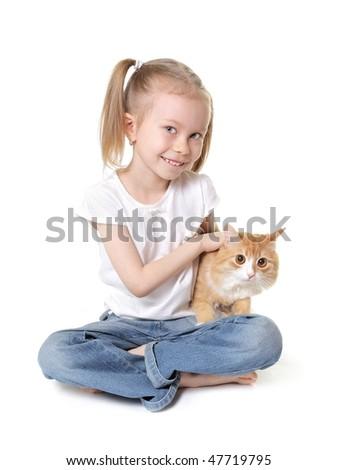 cute little girl with a kitten studio shot on white - stock photo