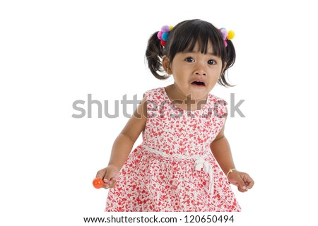 cute little girl with a lollipop isolated on white background