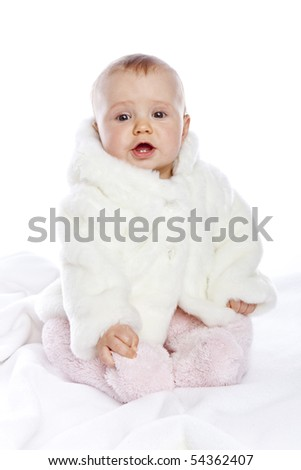 Cute little girl with a warm coat on white background