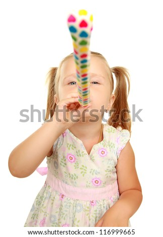 Cute little girl with blowouts toy