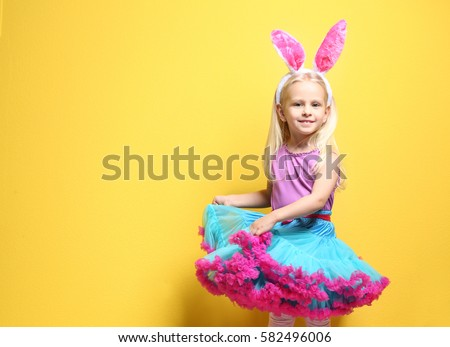 cute little girl with bunny...