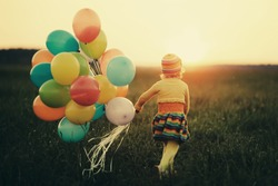 cute little girl with colorful balloons
