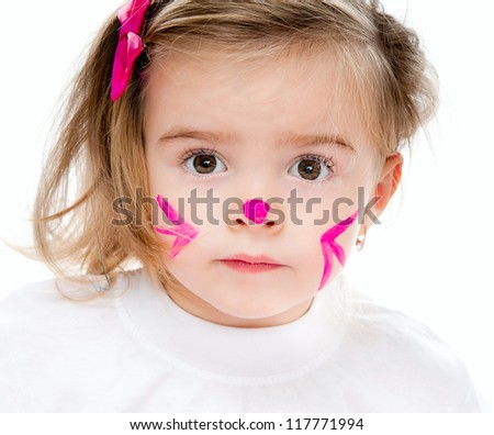 cute little girl with face in paint looks into camera
