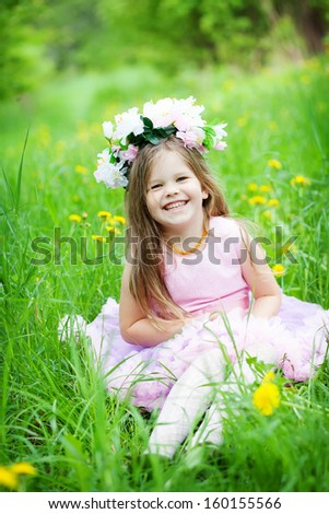 cute little girl with flower wreath outdoors #160155566