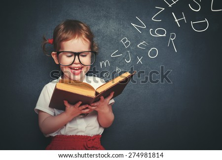 Shutterstock cute little girl with glasses reading a book with departing letters about Chalkboard