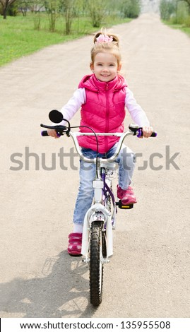 Cute little girl with her bicycle