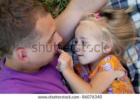 Cute little girl with her father– Outdoor