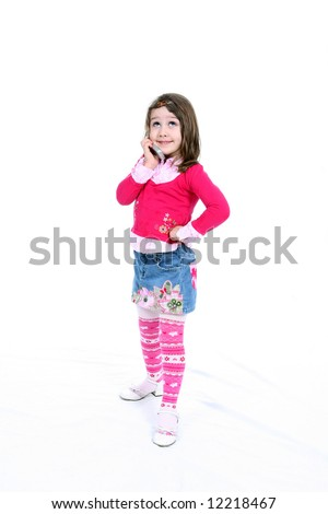 Cute little girl with her hand on her hip, holding a cell phone and rolling her eyes.