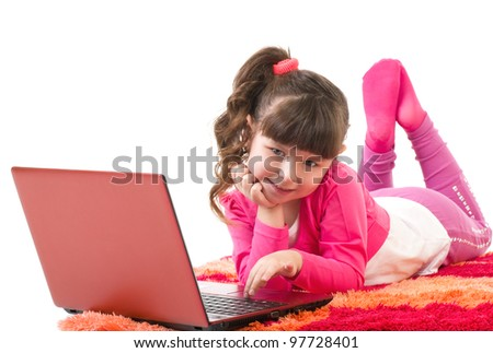 Cute little girl with laptop isolated over white
